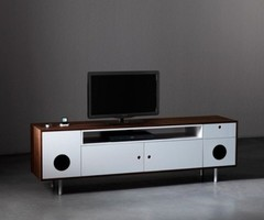 A Console Unit And A Desk With Built-In Audio