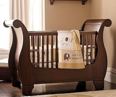 The Larkin Fixed Gate Sleigh Crib Made Of Hardwood Is Ideal For Traditional Nurseries