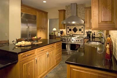 Maple Cabinets With Stainless Steel Appliances, Black Granite Countertops and Maple Cabinets and Entertaining Kitchen For Two Cooks Transitional Kitchen