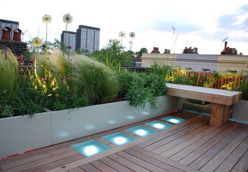 Roof Terrace Design, Roof terrace with decking, glass and dramatic lighting in Holland Park