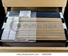 Wooden Rolling File Cabinet With A Drawer Opened, Showing 43 Hanging Folders. Stock Photo 9296248 : Shutterstock