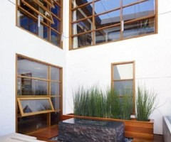Elegant Wooden Tropical House Design by Rockefeller Partners Architects unique natural indoor garden design ideas in wooden house in malibu – HomeConceptDecoration.Com