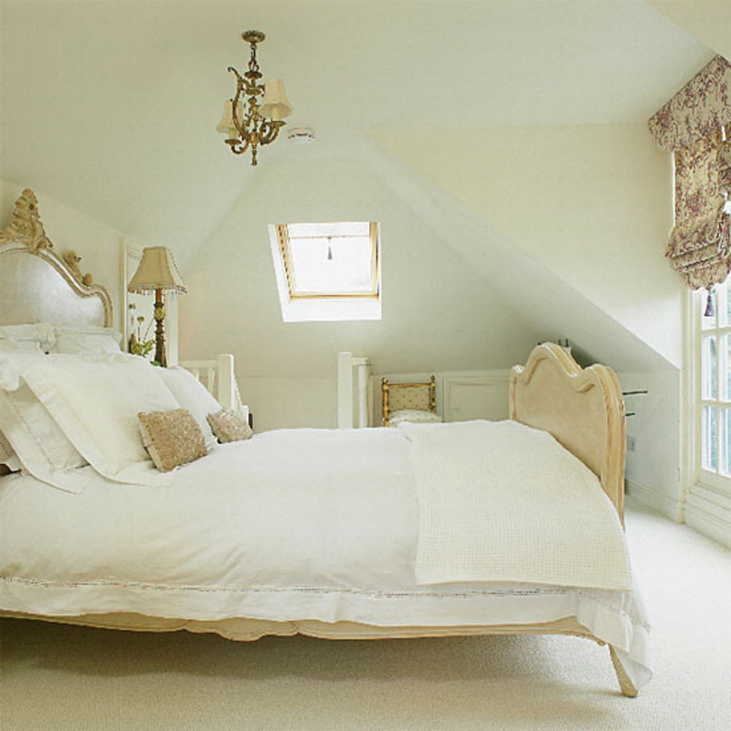Small Loft Bedroom Ideas, Neutral loft bedroom with antique bed and chandelier