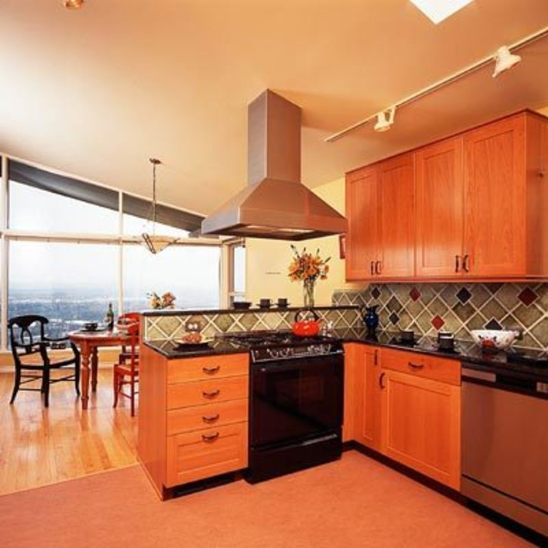 Dark Contemporary Kitchens Red and blue tiles accent wood cabinets