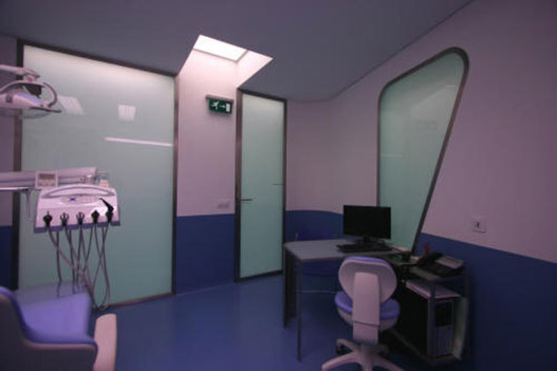 Modern dental clinic interior design inside a smile by for Dental clinic interior designs