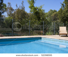 A Luxury Outdoor Pool With Deck Chair Beside It Stock Photo 52398595 : Shutterstock