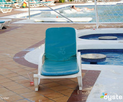 Lounge Chairs at The Outdoor Pool at the Riu Palace Aruba