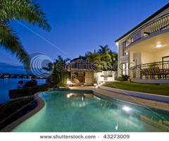 Luxurious Mansion Exterior At Dusk Overlooking Pool, Canal And Bali Hut Stock Photo 43273009 : Shutterstock