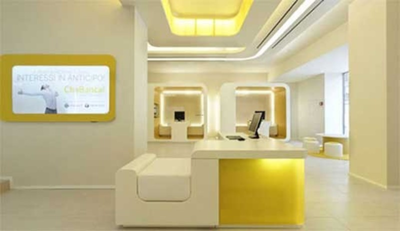 Modern bank interior design by crea international futuristic yellow bank interior decorating for Banc interieur design