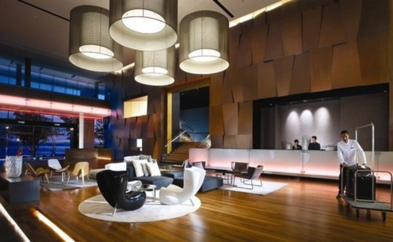 Modern hotel lobby interior design with unique lamp for Modern hotel decor