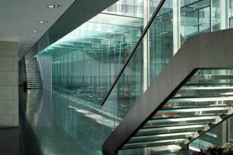 Solid glass balustrade staircase in modern commercial for Office stairs design