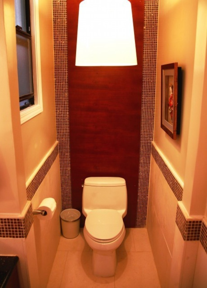 Decorating around a small toilet space in a half bath for Small toilet room design