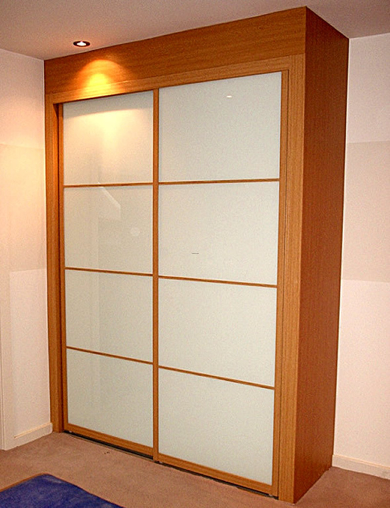 Fitted bedroom furniture with sliding wardrobe doors by for Sliding cupboard doors