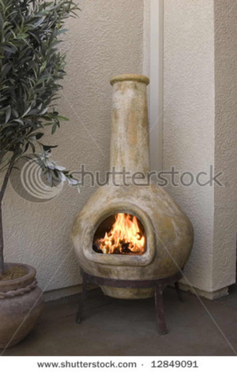 Small Outdoor Patio Fireplace Kiva Design Stock Photo 12849091  # Meuble Tv Fumay