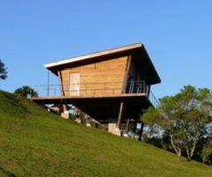 Small Wooden House Contemporary Style On Sloping Terrain