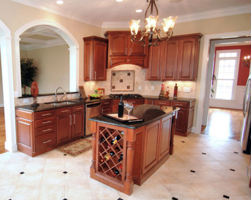 Functional kitchen islands and efficiency in the kitchen for Small kitchen layout with island