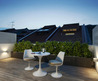 Peaceful Contemporary Roof Terrace Idea By Amir Schlezinger With Warm Yellow Light Under The Bold Shaped Planter