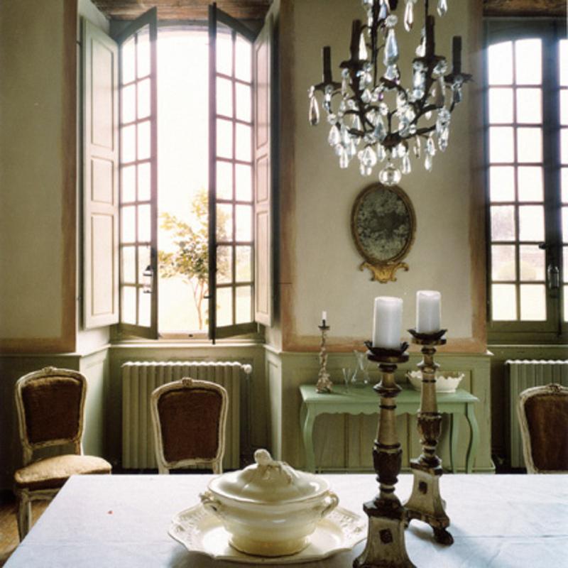 french country dining room with wooden candlesticks