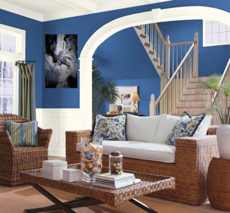 are three blue and brown living rooms designing these