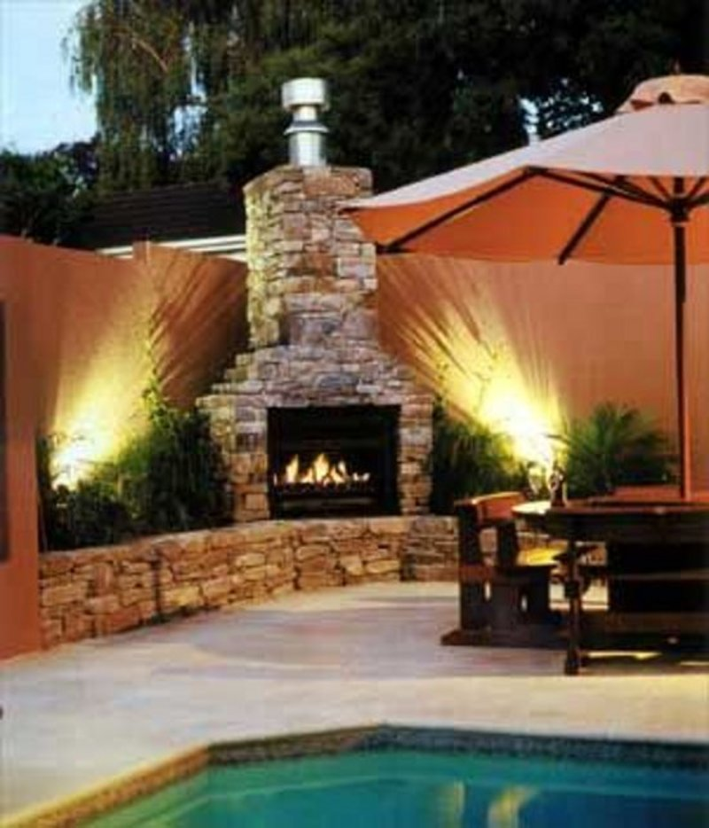 Pool landscaping and outdoor fireplace design image for Pool with fireplace
