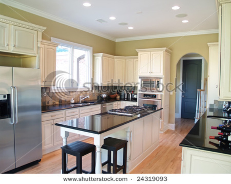 Kitchen, A Modern Kitchen With White Cabinets And Black Granite