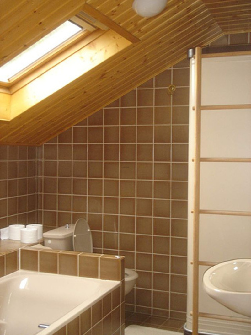Contemporary Bathroom With Slanted Wood Ceiling Design