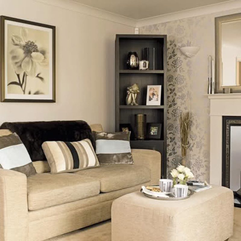 Living Room  And Is Complemented With Warm Cream Furniture And Golden