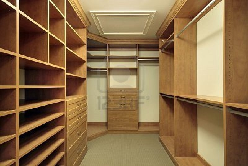 Large Master Bedroom Closet With Wood Paneling Royalty