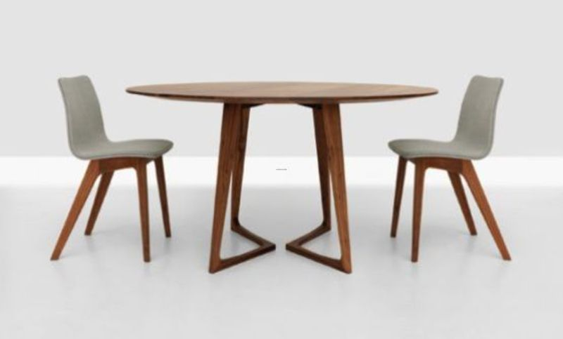 Minimalist dining table 2010 twist by zeitraum moebel twist wooden table round design modern