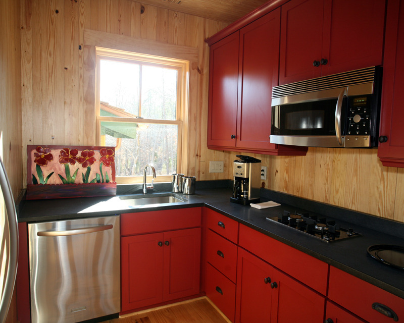 red kitchen design with modern wall mounted cupboards
