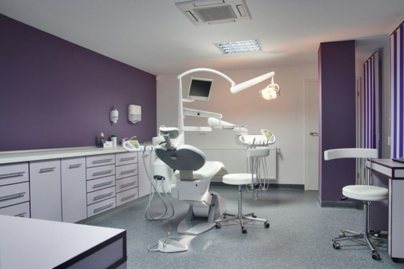 Friendly dental office with baroque design influences in for Dental office interior design