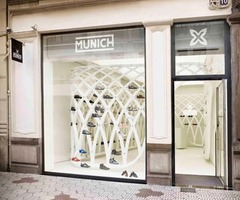 Simple White Interior Design Of Sportswear Store By Dear Design