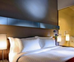 Luxury Bedroom Design With Elegant Lighting Fixtures In Quincy Hotel Singapore