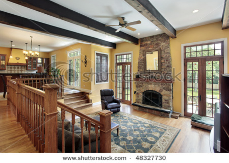 Family Room In Luxury Home With Wood Ceiling Beams Stock