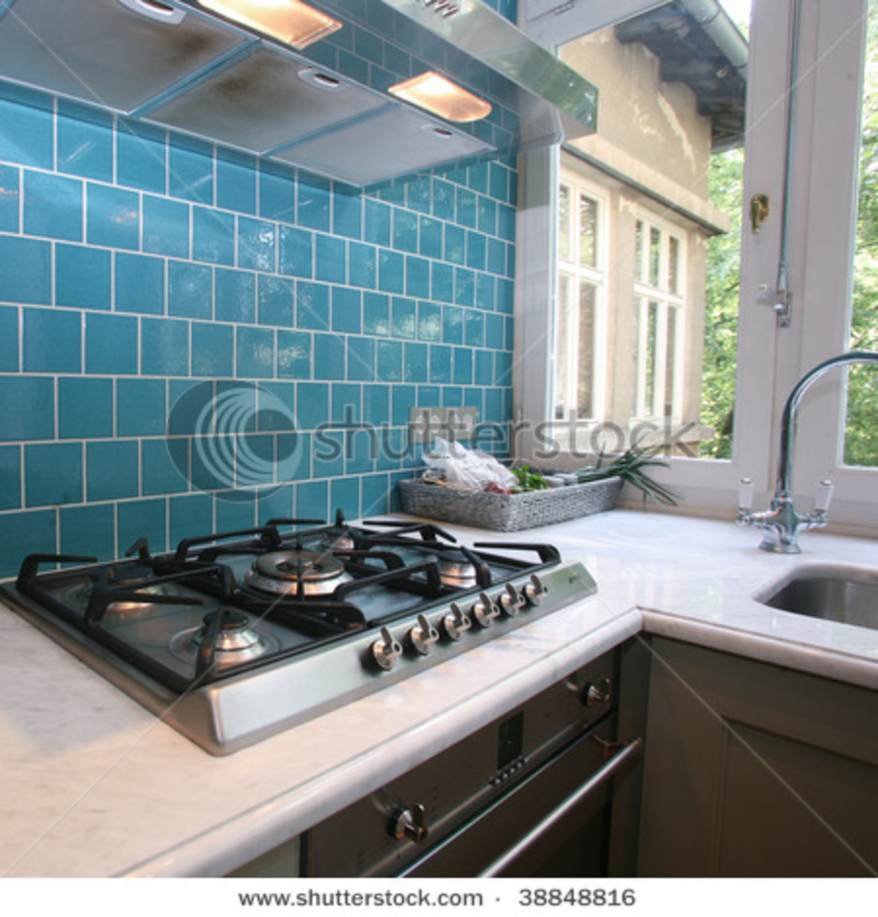 Kitchen Wall Tiles Modern: Modern Kitchen With Turquoise Tiles On Wall Looking Onto