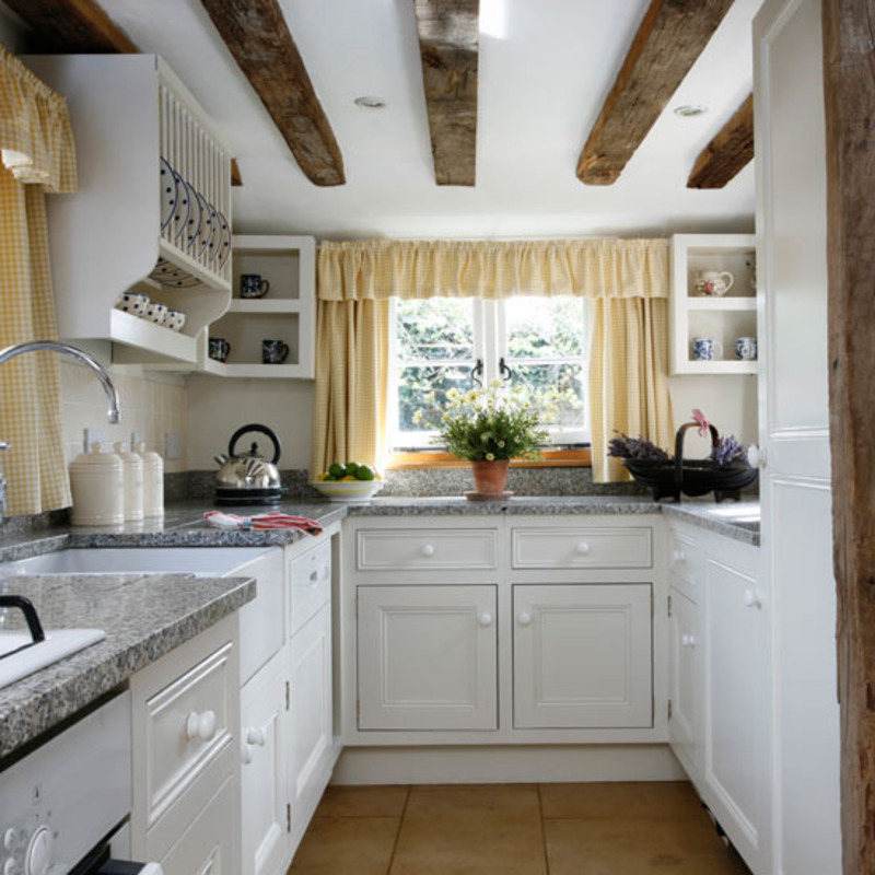 Small Galley Kitchen galley kitchen wooden cabinets warm up this galley style space and