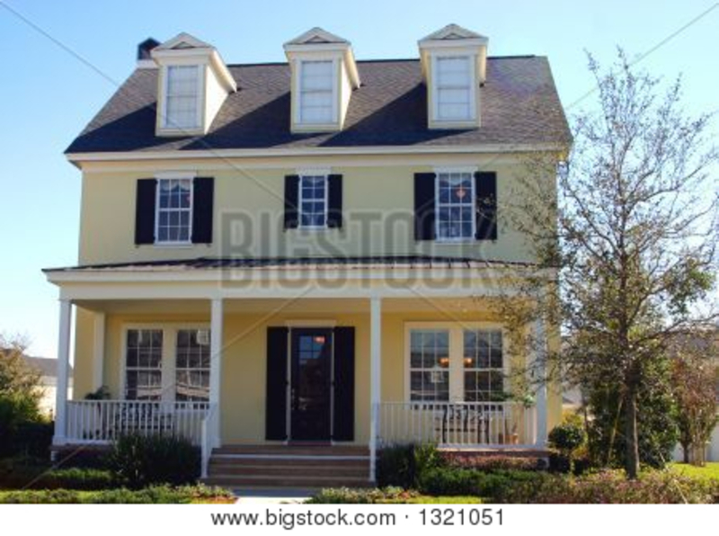 Cape Cod Style House, Yellow Cape Cod Style Dream Home Stock Photo
