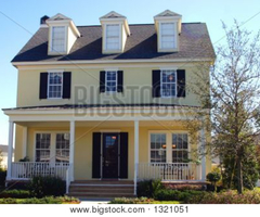 Yellow Cape Cod Style Dream Home Stock Photo