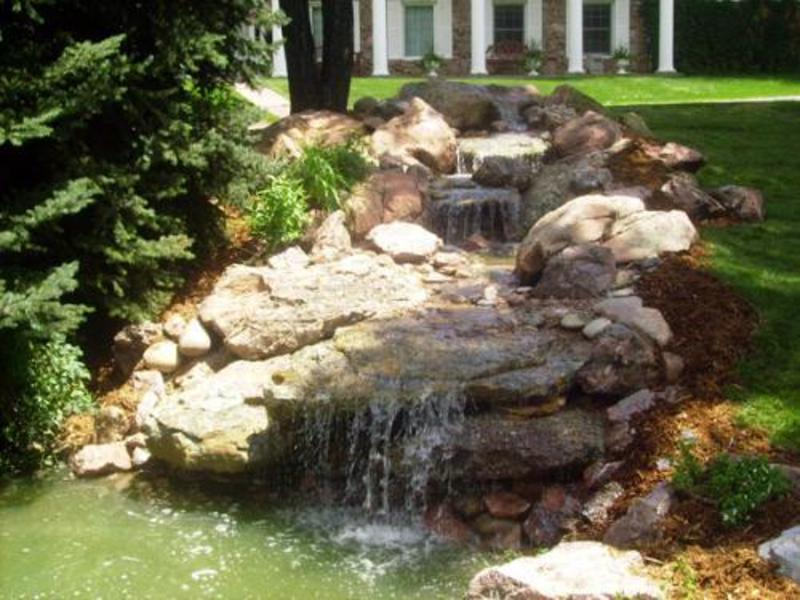 Outdoor water spout ideas Backyard water features