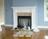 A Fireplace With Travertine Tile