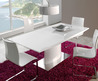 Extremely Modern White Lacquer Dining Table With Heavy Base Larger And Chandelier Also Red Fur Rugs