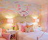 Traditional Kids Bedroom With Pink Castle Wall Mural And Pink Pillows Pink Stripe Chair