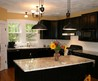 Exotic Dark Themed Ikea Kitchen Idea With Black Kitchen Cabinets And Island With Beige Marble Countertops Also White Backsplash Tile Decor And Pendant Lamps And Flowers Centerpiece
