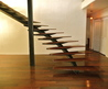 Curved Steel And Walnut Staircase