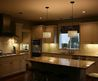 Stylish Kitchen Light Fixtures Feat Narrow Island Table In Addition To Modern Cabinets And Floral Window Curtain