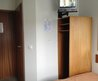 Tv, Wardrobe Next To The Bed, Door To The Bathroom And Entrance Door