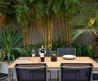 Contemporary Garden With Dining Area Surrounded By Bamboo Plants Beautiful Roof Garden To See How Beautiful The Scenery In The Sky Home Decoration Artificial Grass. Wooden Floor Plan Terrace. Outdoor Living Space.