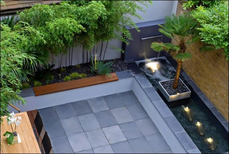 Contemporary Courtyard Water Fall And Bamboo Plants Around The