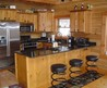 Elegant Concepts Of Rustic Kitchen Cabinets Designed By Black Pearl Granite Countertops And Brown Wooden Kitchen Cabinet Added By Unique Black Barstools