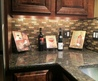 Snazzy L Shaped Gray Granite Countertops And Single Undermount Sink And Rustic Wood Cabinetry Added Gray Mosaic Gloss Glass Tile Backsplash In Hotel Kitchen Designs